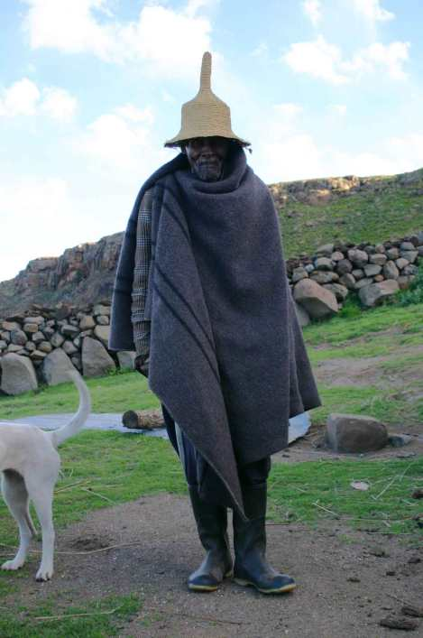 Basotho man in traditional hat and blanket