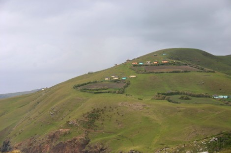 Hike the rolling hills of Wild Coast, dotted with traditional rondavels