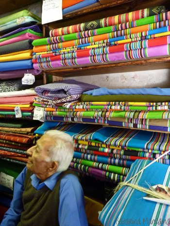 Most fabric shops are owned by Indians. They will offer you the same good price as the local shoppers.